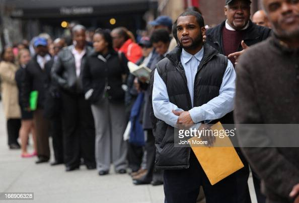 Hundreds of people line up to attend a job fair on April 18 2013 in New York City The event was held by National Career Fairs which expected some 700...