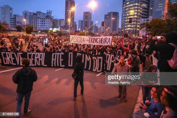 Hundreds of people linked to union forces demonstration on Largo da Batata in Sao Paulo Brazil on April 28 2017 A nationwide general strike has been...