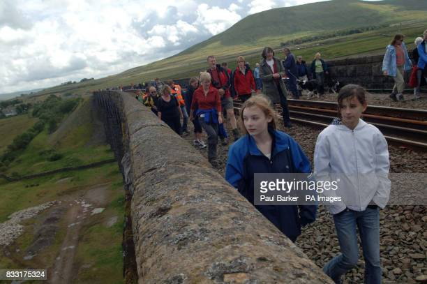 Hundred's of people make the most of today's once in a life time opportunity to walk across the Ribblehead Viaduct on the Carlisle to Settle Railline...