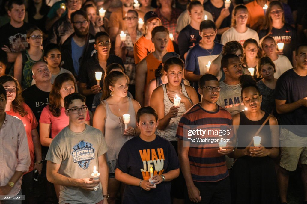 Hundreds of people march peacefully with lit candles across the University of Virginia campus on Wednesday, August 116, 2017, in Charlottesville, VA, in the wake of violence in the city and against torch-lit white nationalist parade the same campus last Friday night.