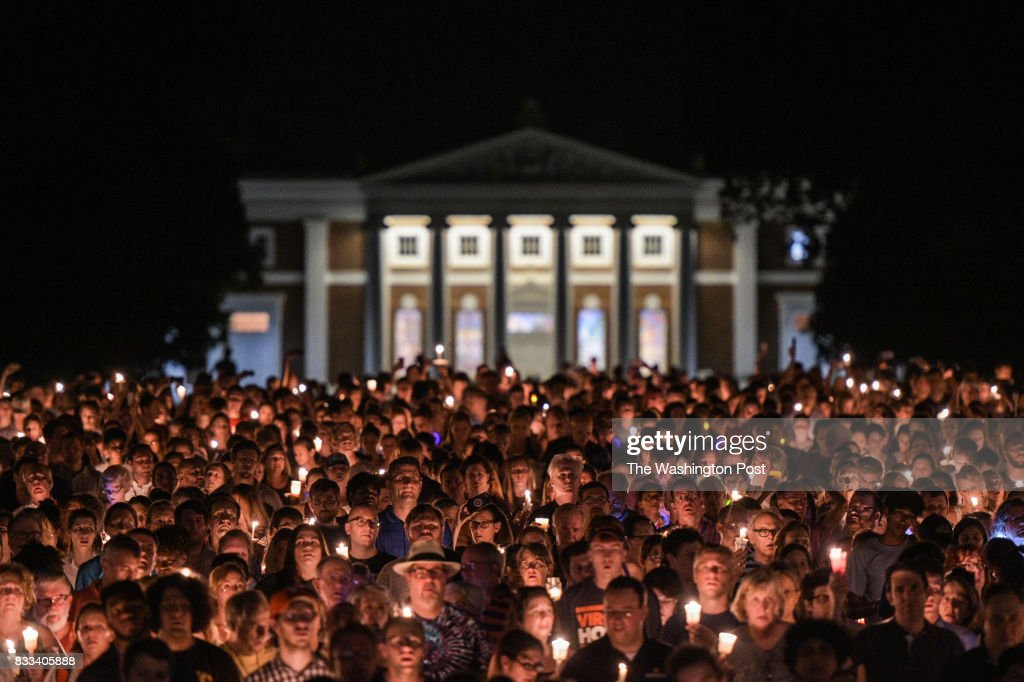 Hundreds of people march peacefully with lit candles across the University of Virginia campus on Wednesday, August 116, 2017, in Charlottesville, VA, in the wake of violence in the city and against torch-lit white nationalist parade the same campus last Friday night. Students and residents gathered at the universitys Rotunda in Charlottesville to sing together for an evening vigil that stood in stark contrast to last weeks torch-lit march of white supremacists.
