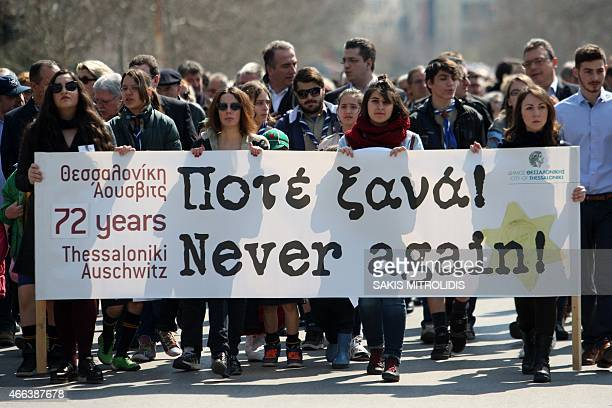Hundreds of people march to the old railway station in Thessaloniki on March 15 2015 during a commemoration ceremony marking the departure of the...
