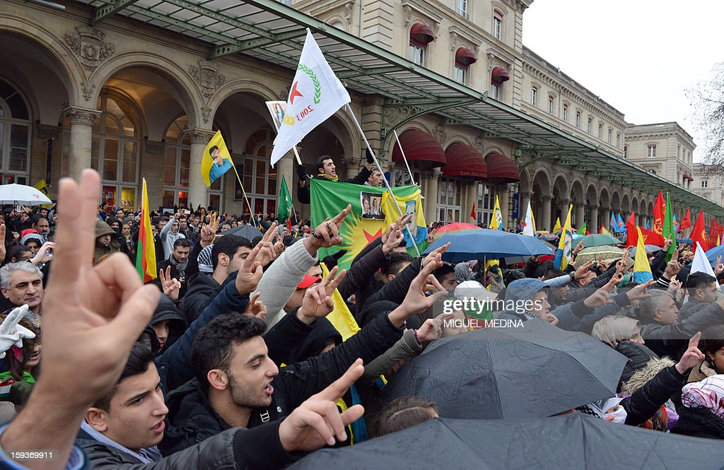 Hundreds of people of Kurdish origin flash the 'V' sign for victory during a demonstration on January 12, 2013 in Paris, two days after the killing of three Kurdish women activists at Paris Kurdistan Information Bureau. Thousands of Kurds from all over Europe are expected in Paris today for what is expected to be an angry protest over the killing of three female activists shot dead at least three times in the head, giving further credence to the theory of an execution-style hit. Kurdish activists have accused Turkey or rogue nationalist elements in the country's military of being behind the killings.