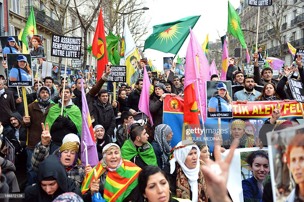 Hundreds of people of Kurdish origin take part in a demonstration on January 12, 2013 in Paris, two days after three Kurdish women were found shot dead at Paris Kurdistan Information Bureau. Thousands of Kurds from all over Europe are expected in Paris today for what is expected to be an angry protest over the killing of three female activists shot dead at least three times in the head, giving further credence to the theory of an execution-style hit. Kurdish activists have accused Turkey or rogue nationalist elements in the country's military of being behind the killings. AFP PHOTO / MIGUEL MEDINA