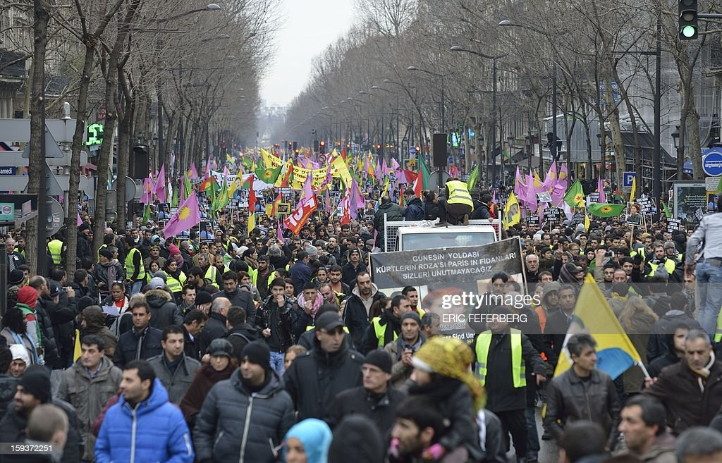 Hundreds of people of Kurdish origin take part in a demonstration on January 12, 2013 in Paris, two days after three Kurdish women were found shot dead at Paris Kurdistan Information Bureau. Thousands of Kurds from all over Europe are expected in Paris today for what is expected to be an angry protest over the killing of three female activists shot dead at least three times in the head, giving further credence to the theory of an execution-style hit. Kurdish activists have accused Turkey or rogue nationalist elements in the country's military of being behind the killings. AFP PHOTO / ERIC FEFERBERG
