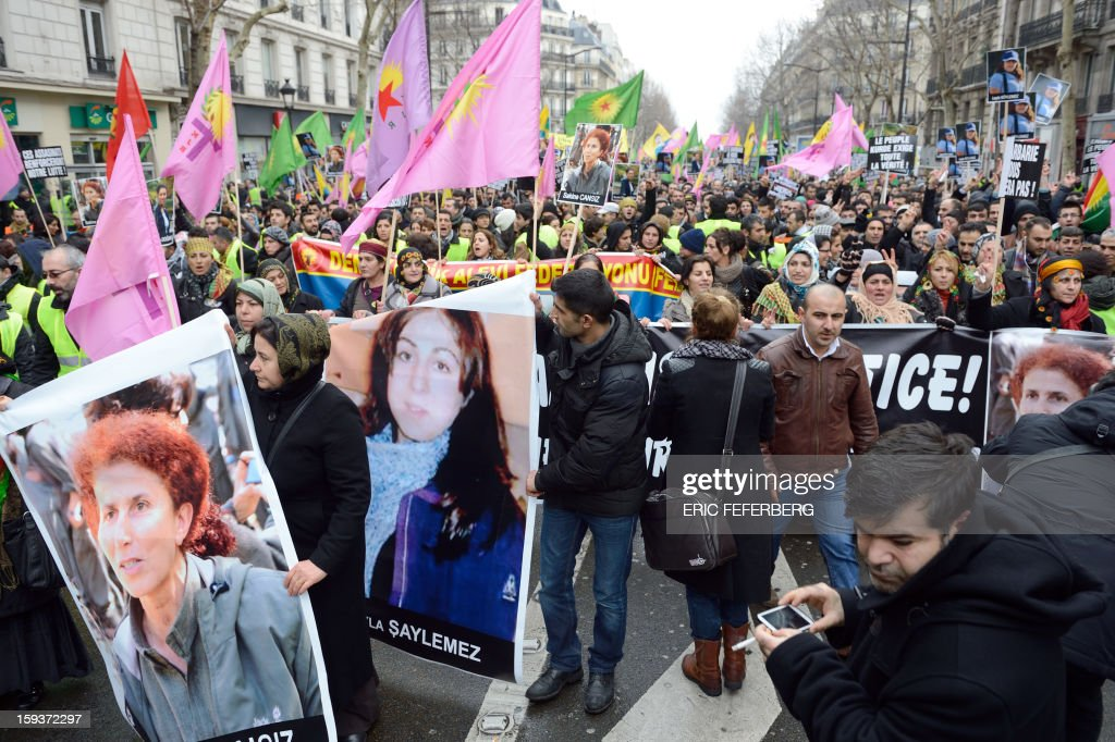 Hundreds of people of Kurdish origin take part in a demonstration on January 12, 2013 in Paris, two days after three Kurdish women were found shot dead at Paris Kurdistan Information Bureau