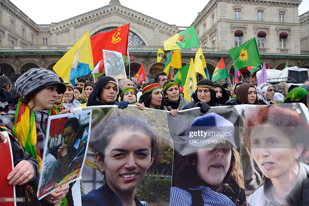 Hundreds of people of Kurdish origin take part in a demonstration on January 12, 2013 in Paris, two days after three Kurdish women were found shot dead at Paris Kurdistan Information Bureau. Thousands of Kurds from all over Europe are gathered in Paris today for what is expected to be an angry protest over the killing of three female activists shot dead at least three times in the head, giving further credence to the theory of an execution-style hit. Kurdish activists have accused Turkey or rogue nationalist elements in the country's military of being behind the killings. AFP PHOTO /ERIC FEFERBERG