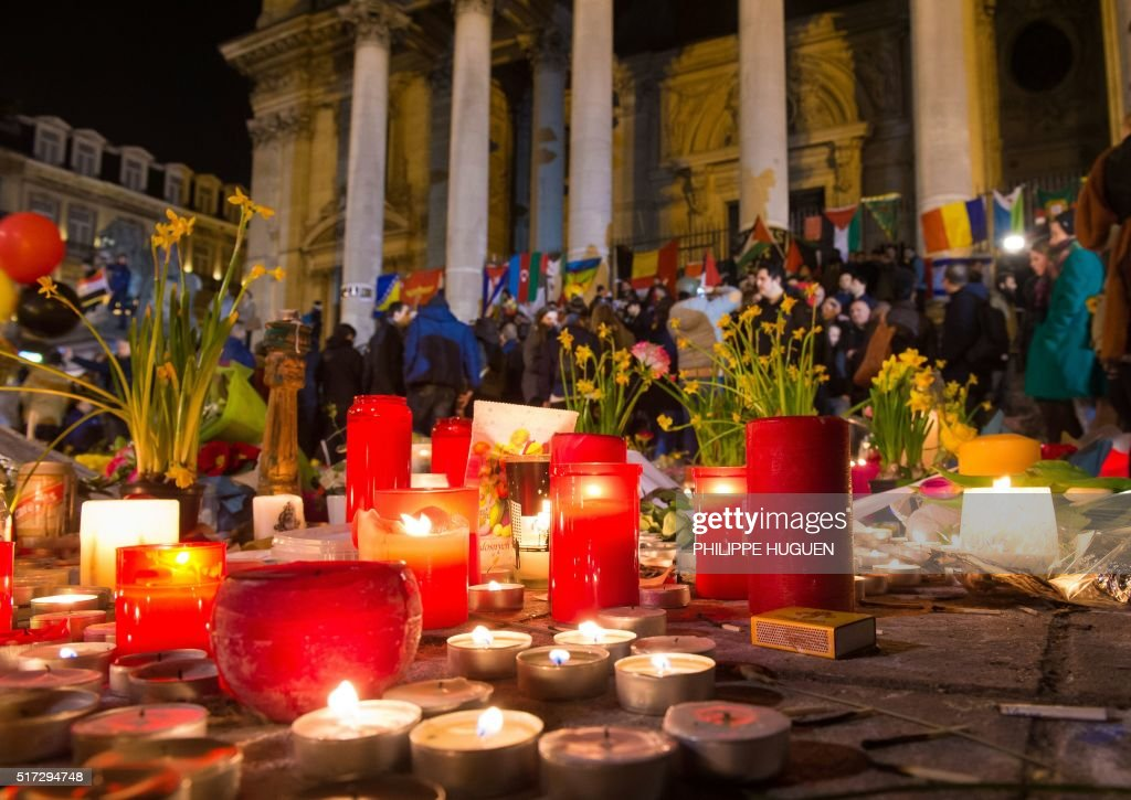 Hundreds of people People gather at a makeshift memorial in front of Brussel's Stock Exchange on Place de la Bourse on March 24 two days after a...