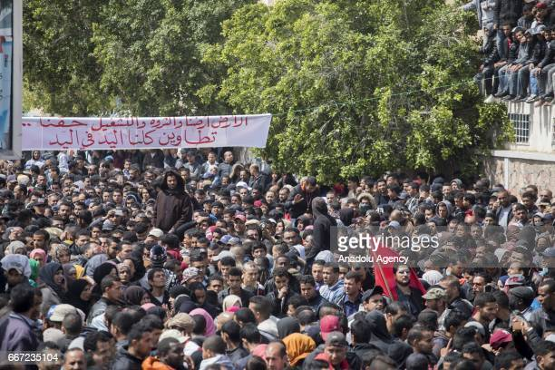 Hundreds of people stage a protest against unemployment demanding foreign petroleum companies to employ local residents in the area in Tataouine...