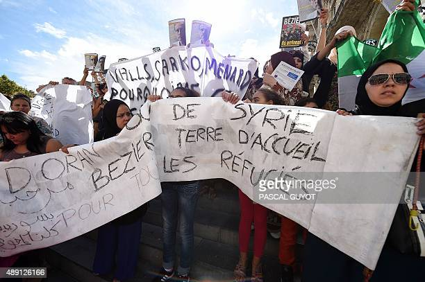 Hundreds of people take part in a demonstration to protest against the mayor of the city and to support Syrian refugees on September 19 2015 in...