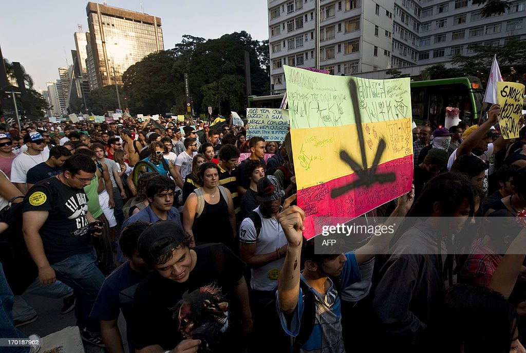 Hundreds of people take part in a march demanding the legalization of marijuana on June 8, 2013, in Sao Paulo, Brazil.
