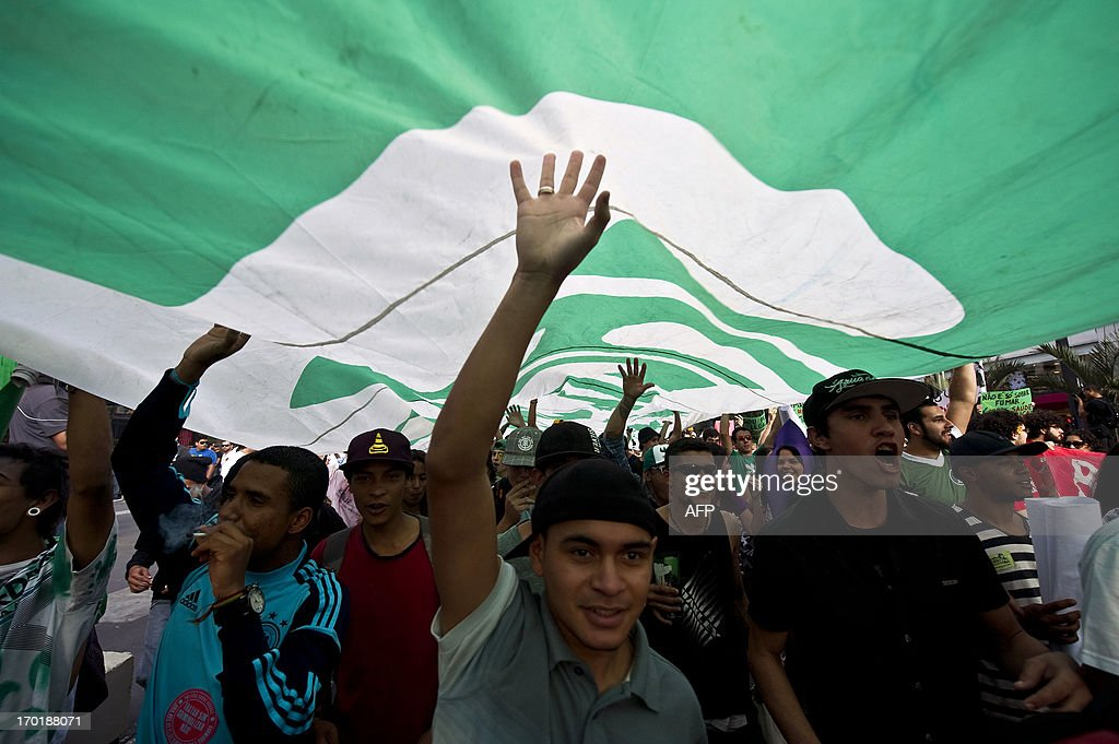 Hundreds of people take part in a march demanding the legalization of marijuana on June 8, 2013, in Sao Paulo, Brazil. AFP PHOTO / NELSON ALMEIDA