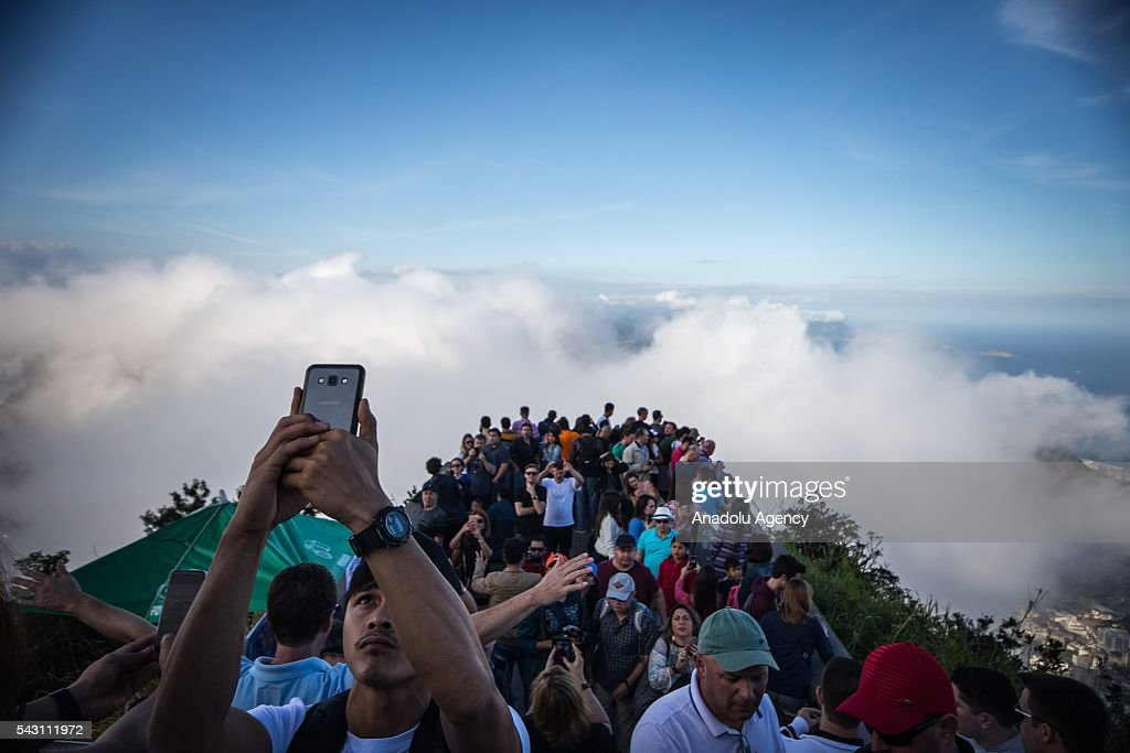 Hundreds of people take pictures and enjoy the view from the Corcovado hill viewpoint, a place that is located the statue of Christ the Redeemer in Rio de Janeiro, Brazil as the preparations for the Olympics continue on June 25, 2016. More than 10,500 athletes from 206 National Olympic Committees (NOCs), including first time entrants Kosovo and South Sudan, are scheduled to take part.