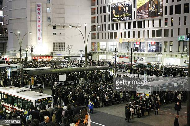 Hundreds of people wait for busses at a Tokyo bus terminal as commuter trains stopped their services in the Tokyo metropolitan area on March 11 2011...