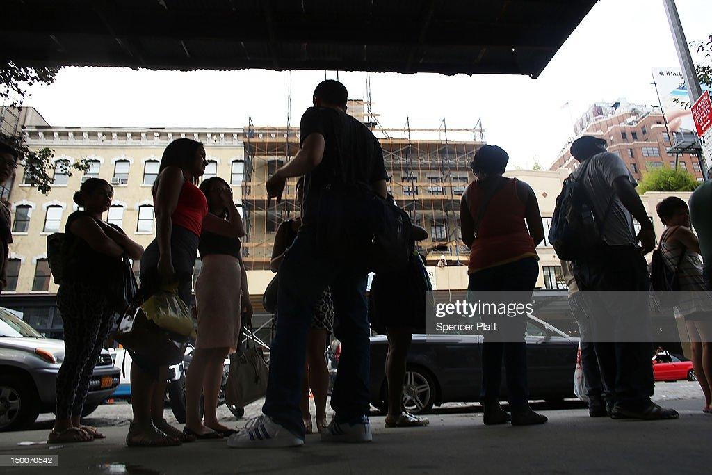 Hundreds of people wait in line for a free vibrator sex toy being distributed by the Trojan condom company from their 'Pleasure Carts' on August 9, 2012 in New York City. The carts, which resemble traditional hot-dog carts, had to shut down during a give-away on Wednesday due to large crowds.