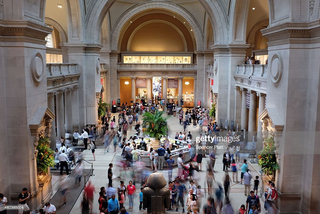Hundreds of people walk through the Great Hall at the Metropolitan Museum of Art on July 30 2015 in New York City The Met recently announced that it...