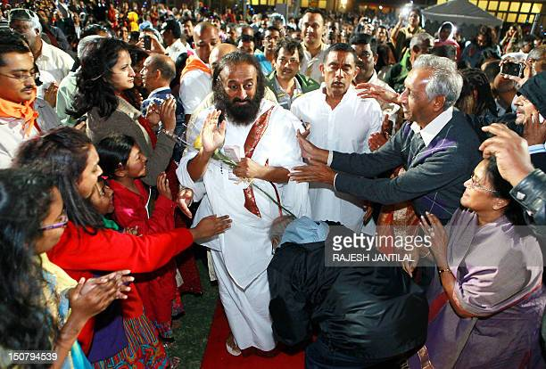 Hundreds of people welcome Indian spiritual guru and Art of Living Foundation leader Sri Sri Ravi Shankar during 'An Evening of Wisdom and...