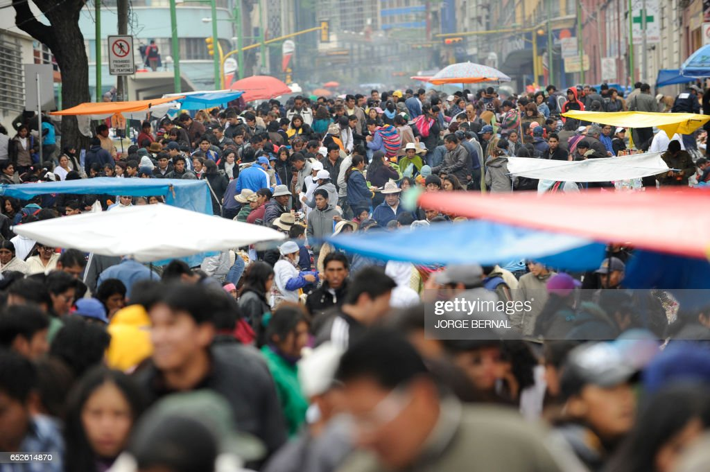 Hundreds of persons participate in the Alasitas --'buy from me' in native language-- festival to honor the Ekeko, the Aymara God of Abundance, on January 24, 2012 in La Paz