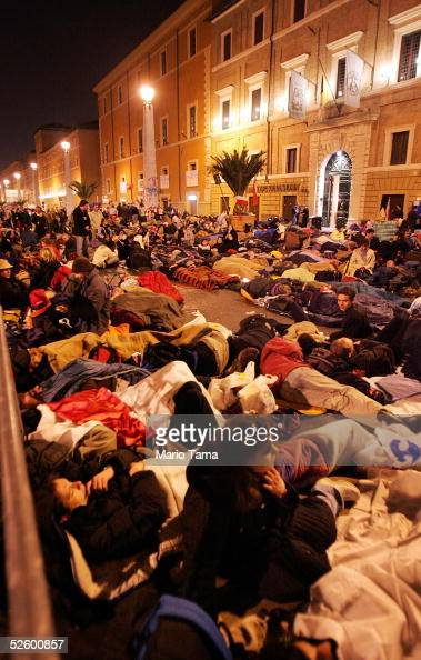 Hundreds of pilgrims camp outside Saint Peter's Square just past midnight waiting for the funeral of Pope John Paul II April 8 2005 in Rome Italy The...