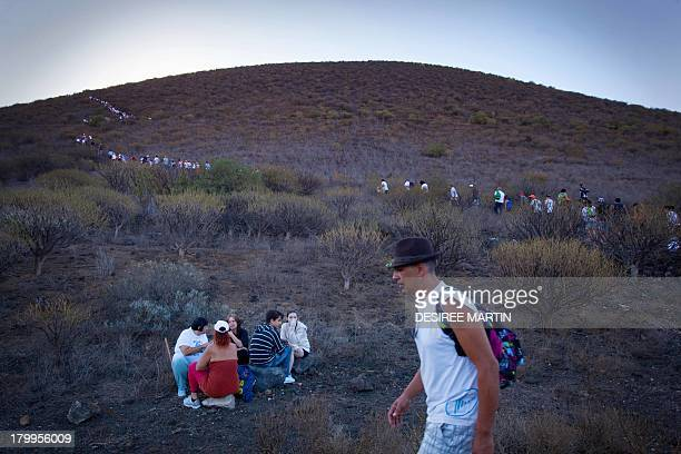 Hundreds of pilgrims take part in the annual pilgrimage of the Virgin del Socorro on the Spanish Canary island of Tenerife on September 7 2013 The...
