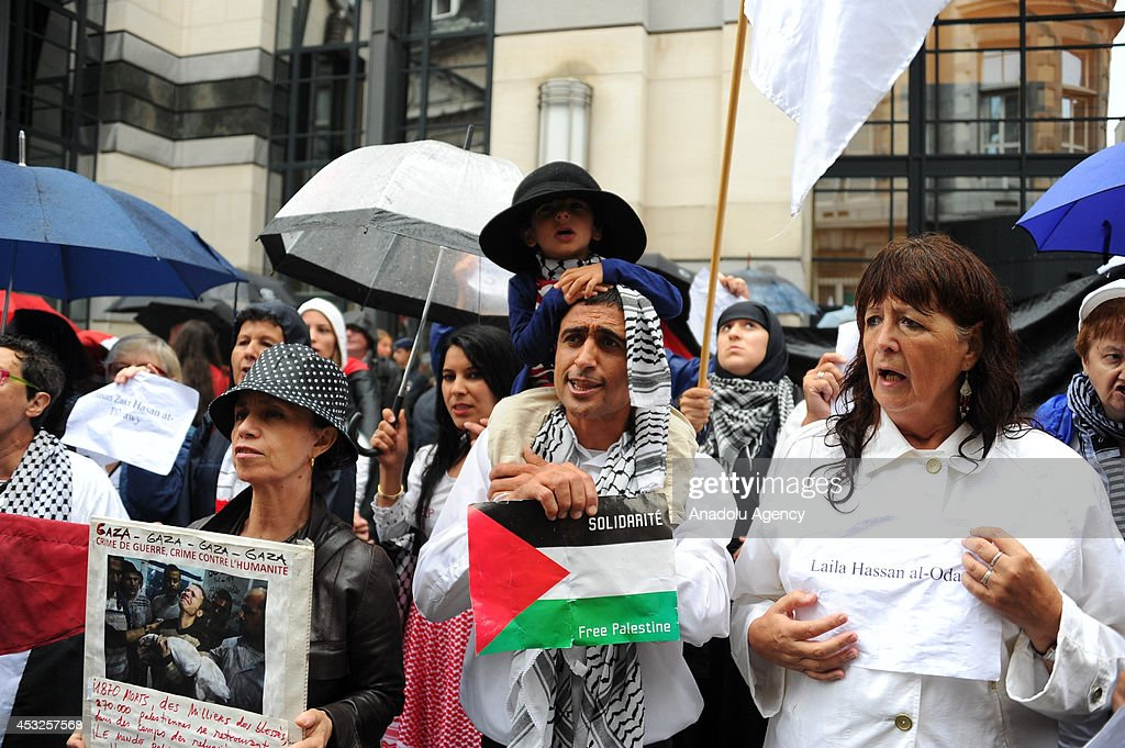Hundreds of pro-Palestinian people stage a solidarity demonstration for Gaza and protest the Israeli attacks against Palestinians, outside the Belgium Foreign Ministry building in Brussels, Belgium on August 6, 2014. Demonstrator hold banners and Palestinian flags during the demonstration.