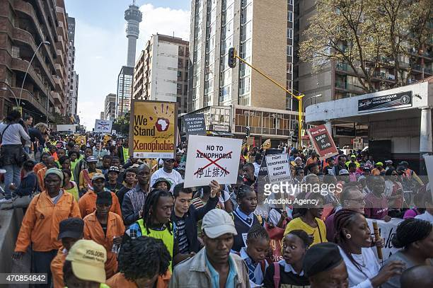 Hundreds of protesters carry placards as they march during an antixenophobia demonstration in Johannesburg South Africa on April 23 2015 In recent...
