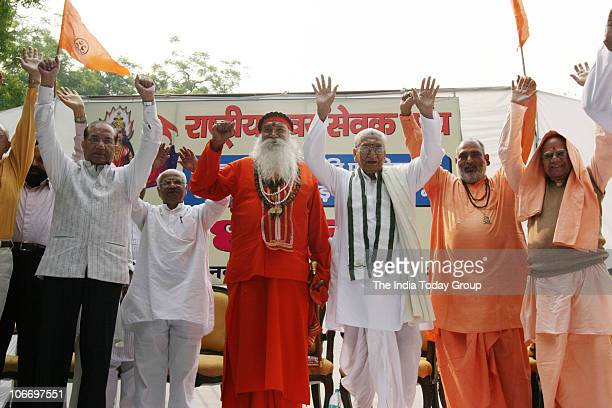 Hundreds of Rashtriya Swayamsevak Sangh activists led by their top leaders staged protests at Jantar Mantar in New Delhi on Wednesday November 10 2010