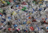 Hundreds of recycled plastic water bottles are piled up inside the Recology recycling facility on March 15 2011 in San Francisco California The...