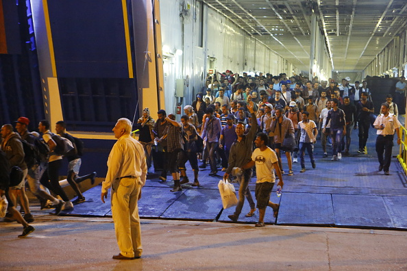 Hundreds of refugees from the island of Lesbos disembark...