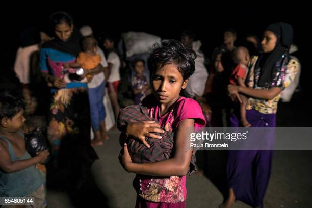 Hundreds of Rohingya arrive by boats in the safety of darkness on September 26 2017 on Shah Porir Dwip island Cox's Bazar Bangladesh Over 430000...