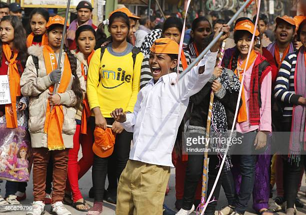Hundreds of RSS Children supporters gather during a peace march staged by Saints as well as students of Arya Samaj to bring unity in spite of caste...