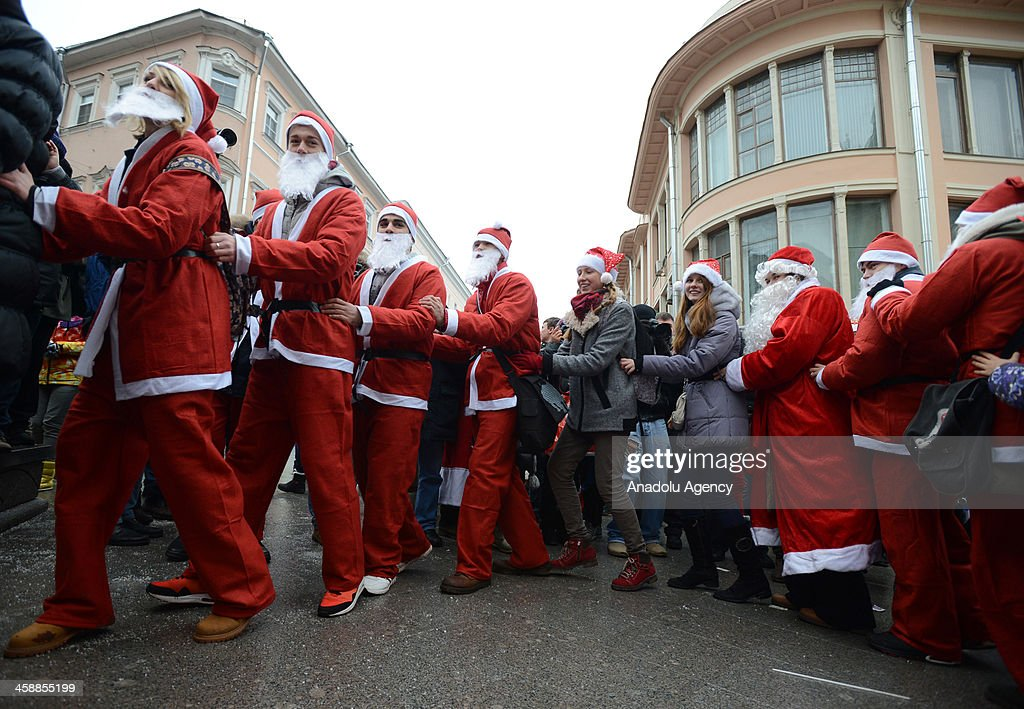 Hundreds of Russian people dressed as Santa Claus gather for children with cancer in order to collect toys at Kuznetsky Most on December 22,2013 in the center of Moscow, Russia. This activity changes the atmosphere at streets prior to Christmas.