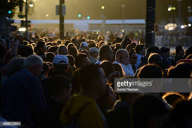 Hundreds of spectators pass through a security check as early as 5 am along the parade route of pope Francis around the Ellipse south of the White...