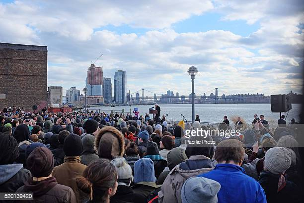 Hundreds of supporters listen to candidate Bernie Sanders speak with East River in the background Senator Bernie Sanders addressed a rally in...