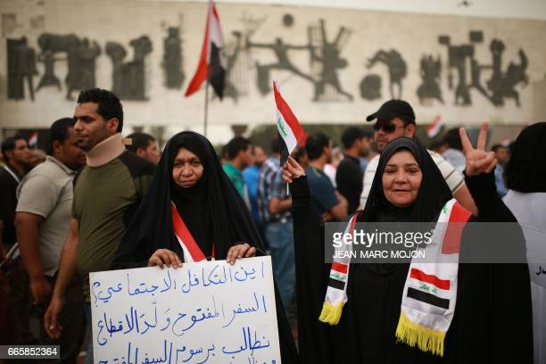 Hundreds of supporters of Iraqi cleric Moqtada Sadr and civil activists hold a protest on Tahrir Square in central Baghdad on April 7 to demand...