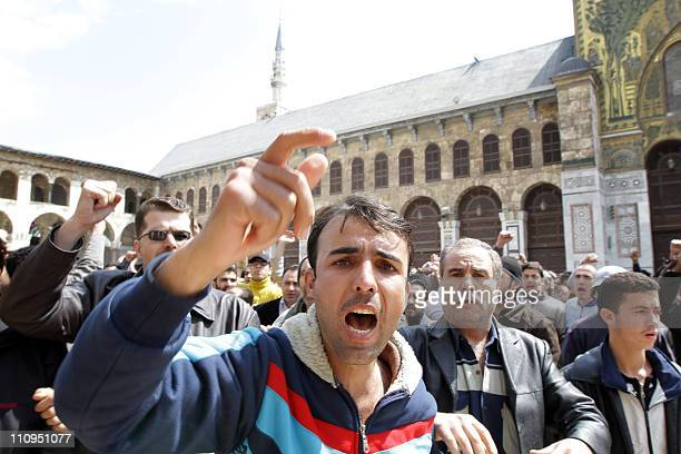 Hundreds of Syrians march from the Omayyed mosque in the centre of Damascus' Old City towards Souk AlHamadiyeh street on March 25 2011 chanting...