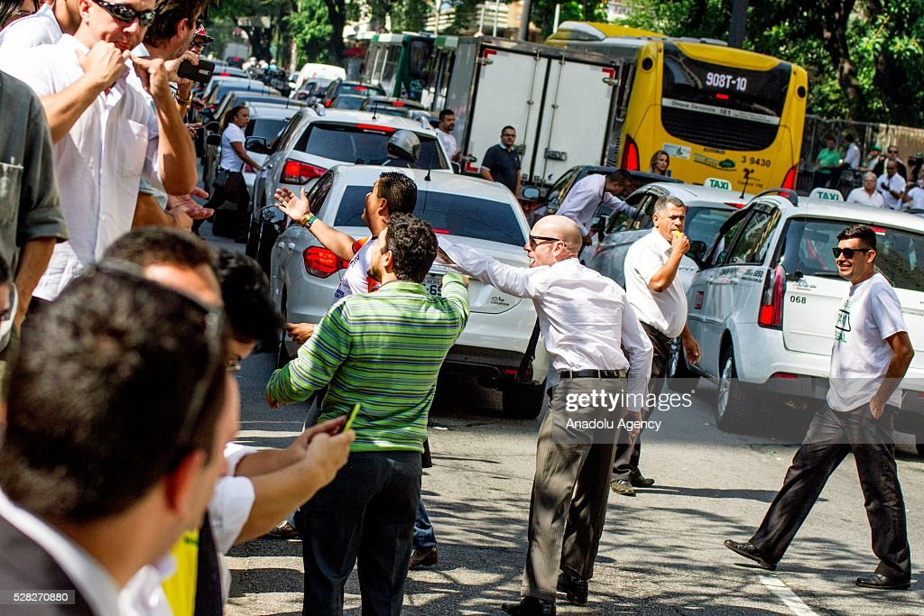 Hundreds of taxi drivers attend a demonstration against the bill of approval regulating taxi service applications such as UBER in Sao Paulo, Brazil on May 04, 2016.