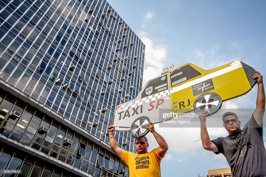 Hundreds of taxi drivers do demonstration against the bill of approval regulating taxi service applications (UBER). Protesters concentrated in front of City Hall in Sao Paulo, Brazil on may 04, 2016.
