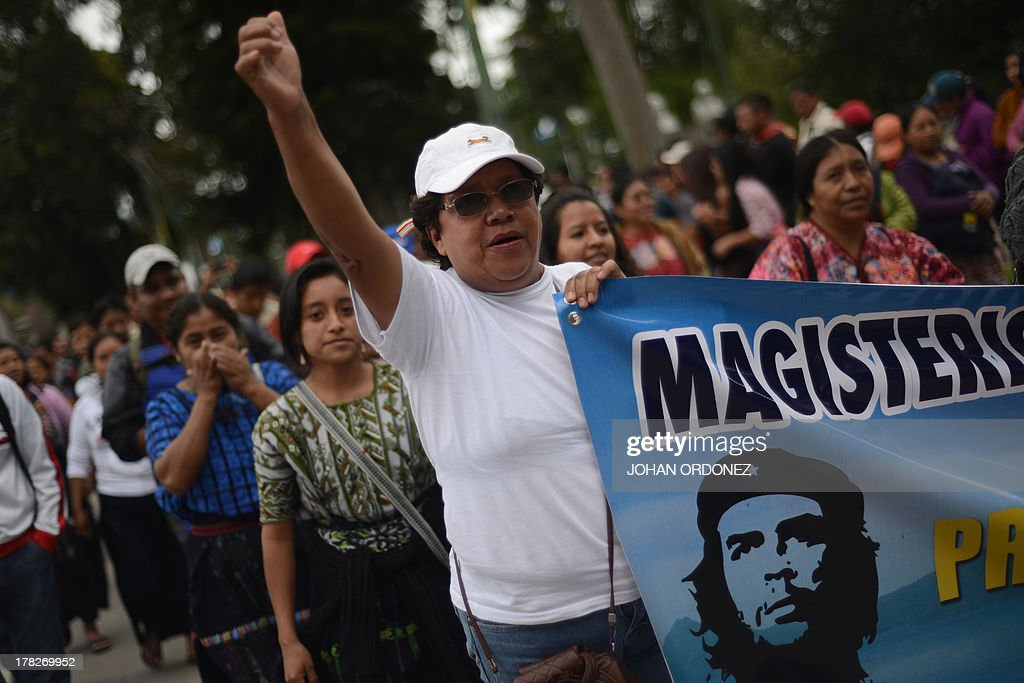 Hundreds of teachers demonstrate in the streets of Guatemala City on August 28, 2013 demanding to the government of Otto Perez Molina a wage increase. AFP PHOTO/Johan ORDONEZ