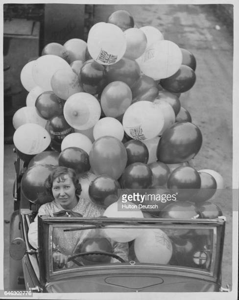 Hundreds of thousands of balloons are being made for the Xmas festivities at a Stoke Newington factory which is run by Miss Ena Spencer and her...