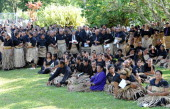 Hundreds of Tongans dressed in black and wearing the traditional ta'ovala waistmats gather to pay their respects to Queen Halaevala Mata'aho the...