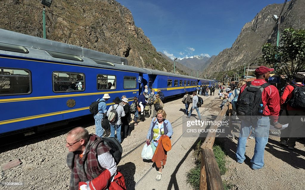Hundreds of tourists board a train from an intermediate station between the Andean city of Cuzco and the Inca fortress citadel Machu Picchu on May 23, 2010 as works to reconstruct the railroad line continues after it was destroyed by the Vilcanota River during the heavy rains that hit this area 1,200 kilometers southeast of Lima last January. The rains isolated hundreds of tourists and collapsed the tourism industry in the city of Cuzco and Machu Picchu during several weeks which regularly receives over 1,000 visitors a day.