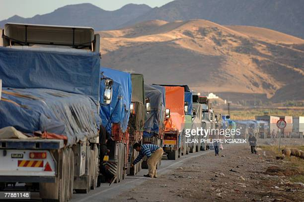 Hundreds of trucks wait near the TurkishIraqi border in the province of Sirnak 13 November 2007 southeastern Turkey Four soldiers one of them an...