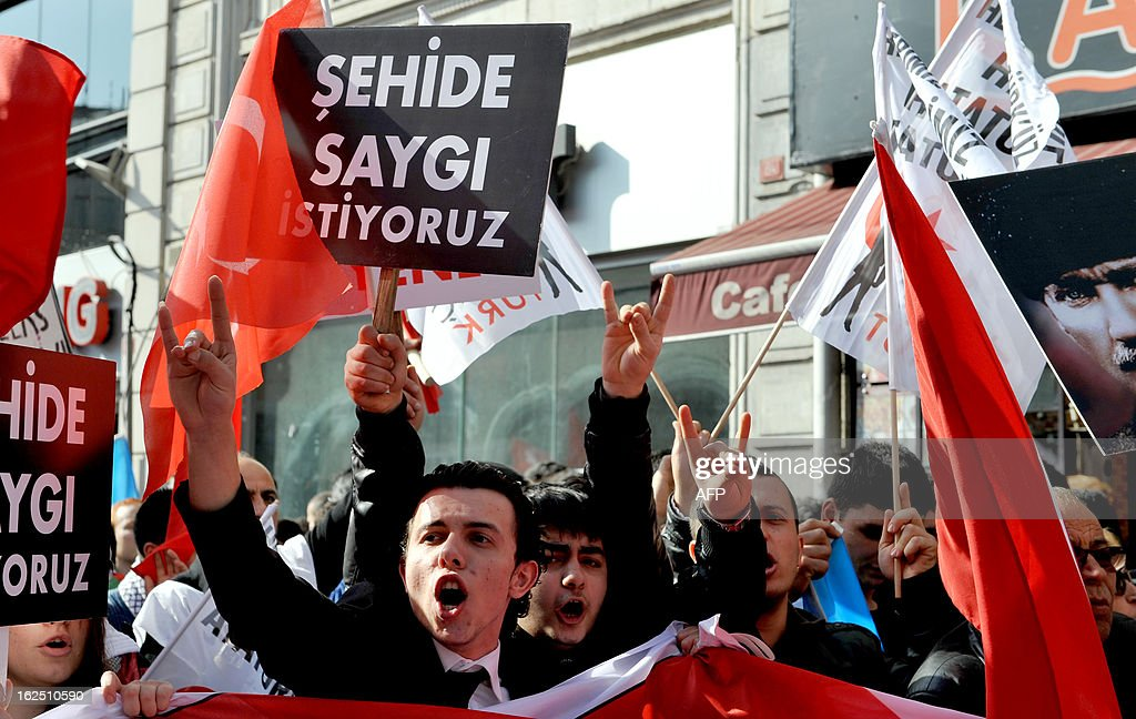 Hundreds of Turkish nationalists hold placards, reading: 'We want respect for martyrs,' on February 24, 2013 during a march on Istiklal Avenue to protest at the resumption of peace talks with Kurd rebels, saying they sullied the memory of soldiers killed in the near three-decade conflict. Many made hand gestures associated with the extreme right-wing group Grey Wolves. The protest was held a day after three Kurdish lawmakers visited Abdullah Ocalan, the jailed leader of the outlawed Kurdistan Workers' Party (PKK), at his island prison, the second such visit since the peace negotiations resumed late last year.