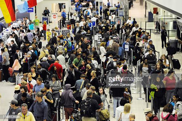 Hundreds of United Airlines passengers stranded at Los Angeles International Airport wait for the computer system to come back up on June 17 2011 in...