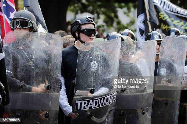 Hundreds of white nationalists neoNazis and members of the 'altright' march down East Market Street toward Emancipation Park during the 'Unite the...