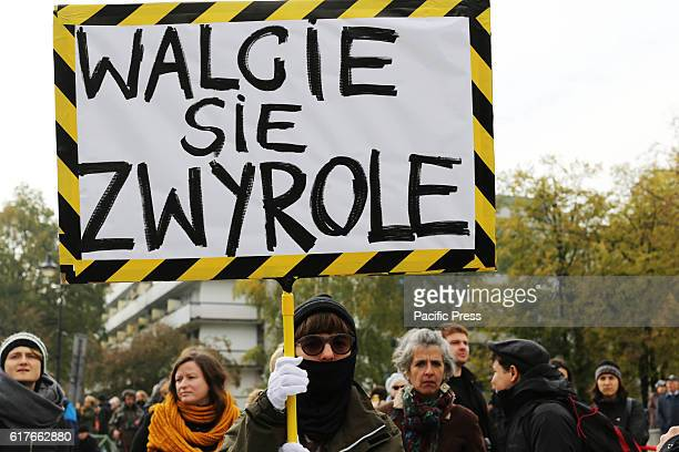 Hundreds of women attended a 'black protest' in Warsaw Poland on October 23 2016 in front of Poland's parliament the Sejm The protest was organized...
