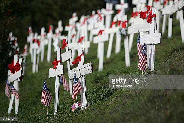 Hundreds of wooden crosses are seen at a roadside memorial honoring military troops that have died in Iraq December 29 2006 in Lafayette California...