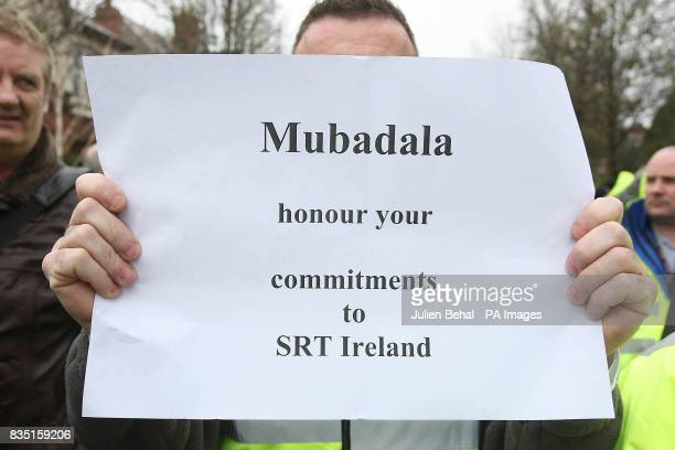 Hundreds of workers who lost their jobs at SR Technics hold a demonstration outside the Swiss embassy in Dublin to protest at the company's proposed...