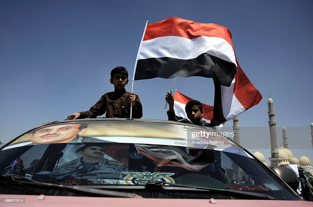 Hundreds of Yemenis who support former Yemeni President Ali Abdullah Saleh's son Ahmed Ali Saleh stage a protest to end political problems in the country and demand early presidential elections at Sebin square in Sanaa, Yemen on March 13, 2015.